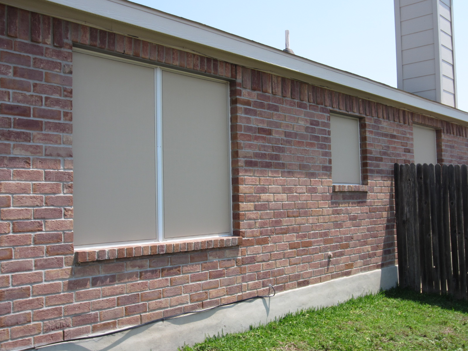 Beige Solar Screen Installation About Us About Our